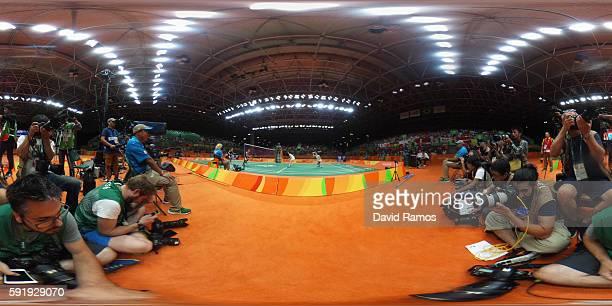 Misaki Matsutomo of Japan plays a shot against Christinna Pedersen and Kamilla Rytter Juhl of Denmark during the Women's Doubles Badminton Gold Medal...
