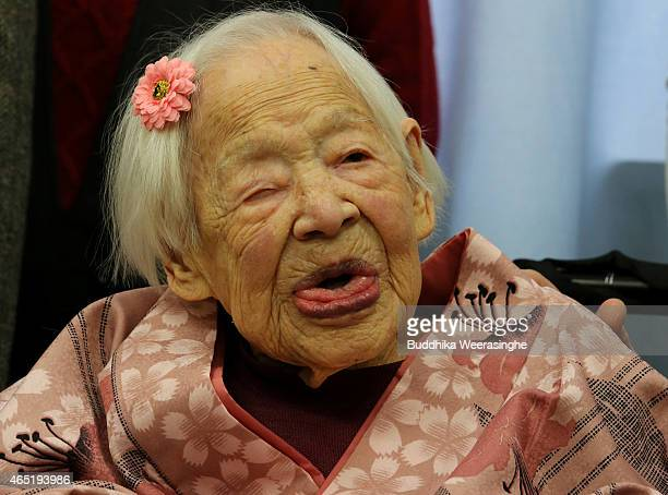 Misao Okawa the world's oldest Japanese woman poses for a photo on her 117th birthday celebration at Kurenai Nursing Home on March 4 2015 in Osaka...
