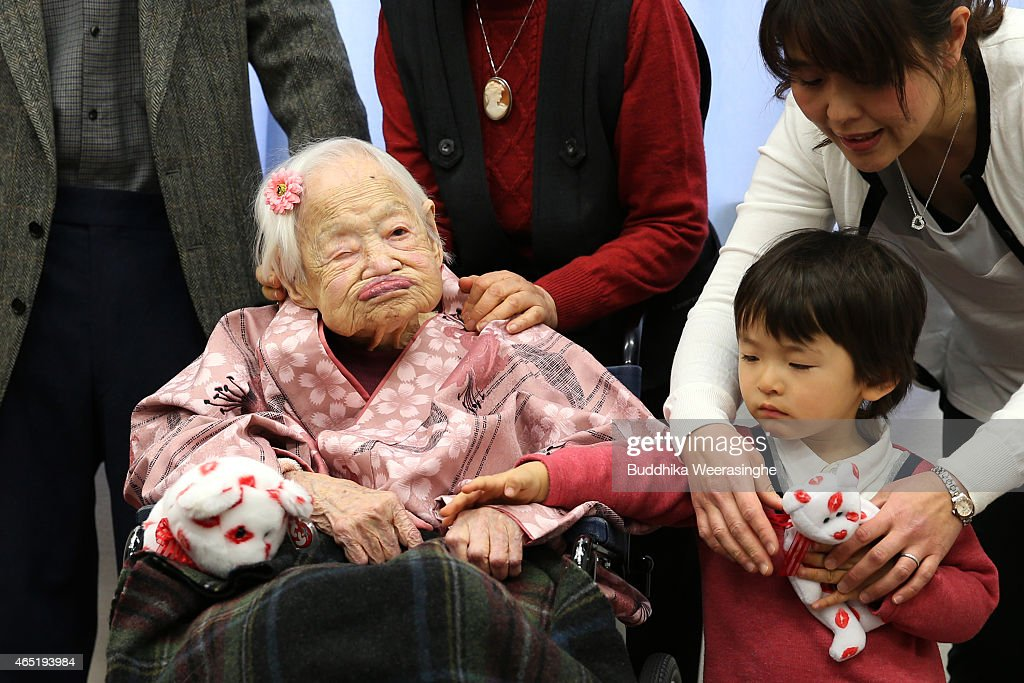 Misao Okawa, the world's oldest Japanese woman poses for a photo with her great-grandchild Himaki and grandchild Takako Okawa on her 117th birthday celebration at Kurenai Nursing Home on March 4, 2015 in Osaka, Japan. Japanese woman Misao Okawa is oldest living person in the world as certified by the Guinness World Records, who celebrates her 117 birthday on March 5. Okawa has been dubbed the worlds oldest living person since the June 12, 2013 death of 116 years and 54 days old Jiroemon Kimura, also Japanese. She is ranked first Oldest Japanese person ever and third person reached to 117in the world.