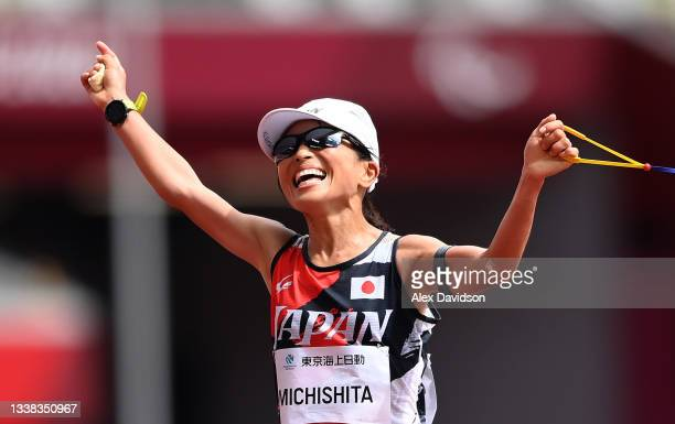 Misato Michishita of Team Japan reacts as she crosses the finish line to win the gold medal during the women's Marathon - T12 on day 12 of the Tokyo...