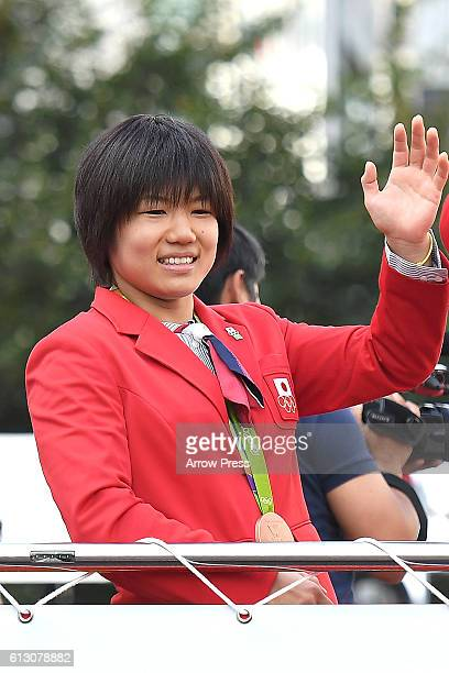 Misato Nakamura waves on the top of a double decker bus during the Rio Olympic Paralympic 2016 Japanese medalist parade in the ginza district on...