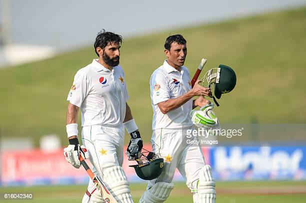 Misbah Ul Haq and Younis Khan leave the ground for tea breakduring Day One of the Second Test between Pakistan and the West Indies at the Zayed...
