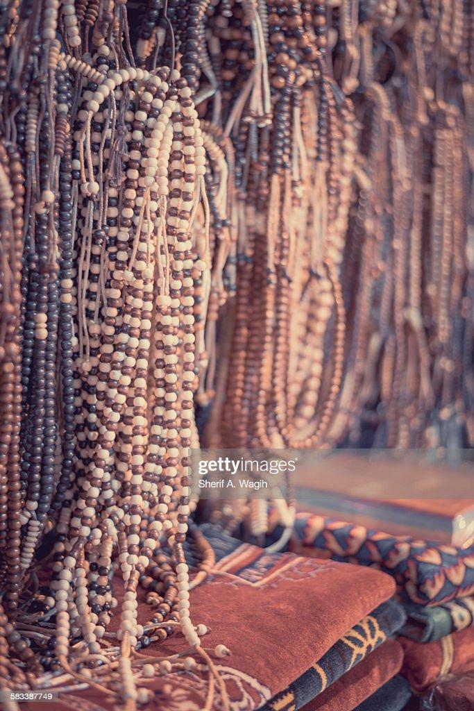 Misbaha, muslim roasary and prayer rugs in moez : Stock Photo
