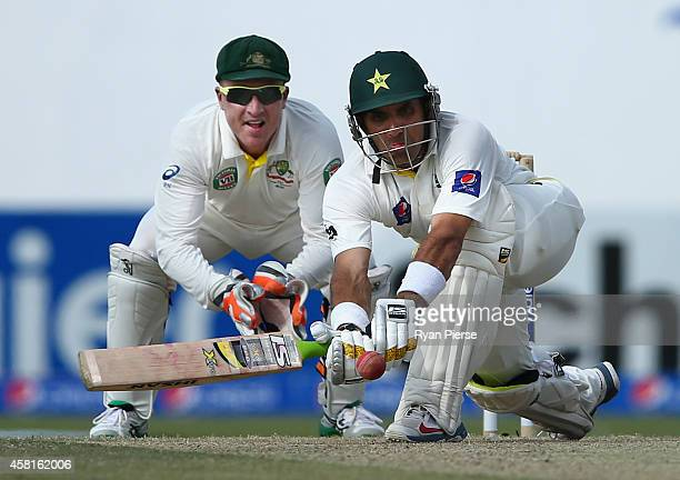 Misbahul Haq of Pakistan bats as Brad Haddin of Australia keeps wicket during Day Two of the Second Test between Pakistan and Australia at Sheikh...