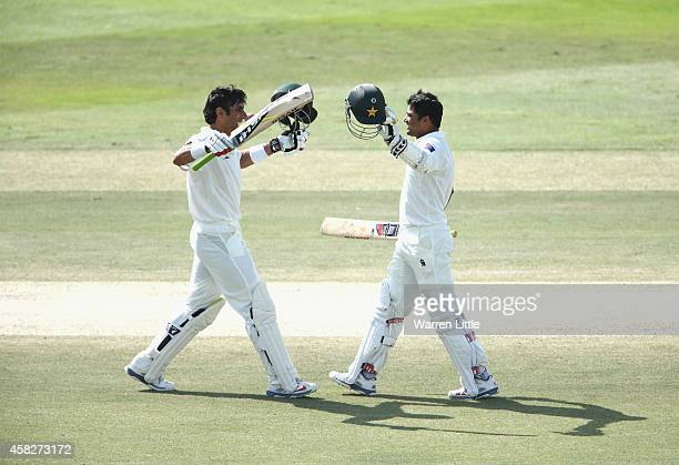 MisbahulHaq and Azhar Ali of Pakistan celebrate as they both reach their centuries during Day Four of the Second Test between Pakistan and Australia...