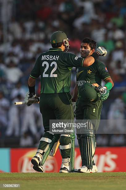 MisbahulHaq and Umar Akmal of Pakistan on reaching their century partnership during the Kenya v Pakistan 2011 ICC World Cup Group A match at the...