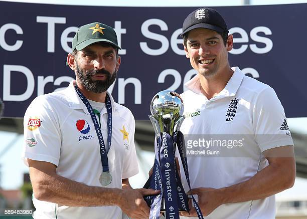 MisbahulHaq of Pakistan and Alastair Cook of England pose with the trophy after the series was drawn day four of the 4th Investec Test match between...