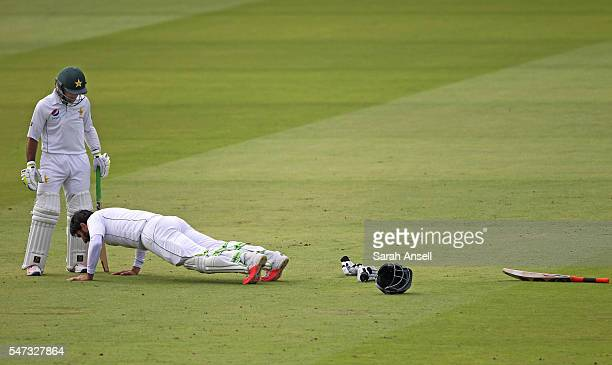 MisbahulHaq of Pakistan celebrates reaching a century with a number of pressups as teammate Asad Shafiq looks on during day 1 of the First Investec...