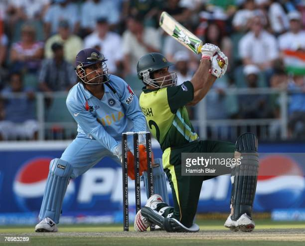 MisbahulHaq of Pakistan in action with MS Dhoni of India looking on during the Twenty20 Championship Final match between Pakistan and India at The...