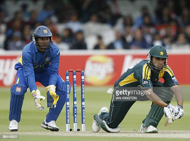 MisbahulHaq of Pakistan plays a reverse shot watched by Kumar Sangakkara of Sri Lanka during the Super 8 stage of the ICC Twenty20 Cricket World Cup...