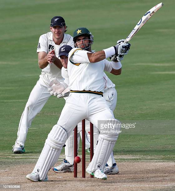 MisbahUlHaq of Pakistan plays a shot as wicket keeper Reece Young of New Zealand Invitation XI looks on during day two of the tour match between the...