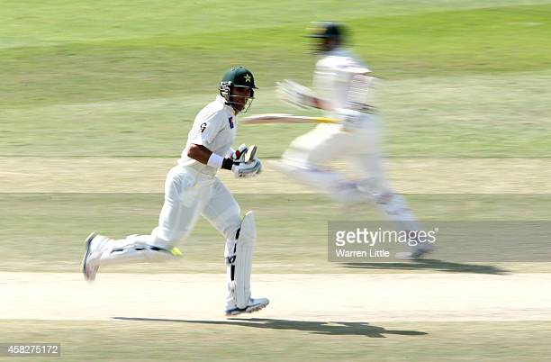 MisbahulHaq Pakistan Captain runs with parnter Azhar Ali en route to equalling the fastest ever test century during Day Four of the Second Test...