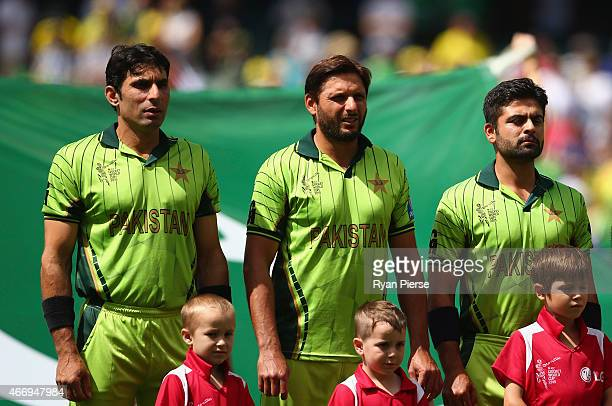 MisbahulHaq Shahid Afridi and Ahmed Shehzad of Pakistan sing the national anthem during the 2015 ICC Cricket World Cup match between Australian and...
