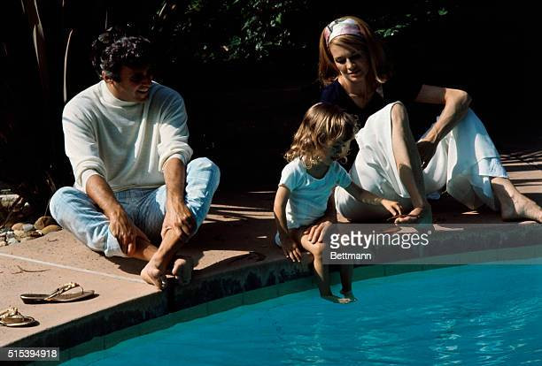 Miscellaneous color shot of composer Burt Bacharach wife Angie Dickinson and daughter Lea Nikki on the grounds and around the swimming pool of their...