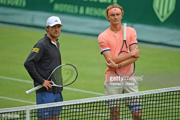 Mischa and Alexander Zverev of Germany wait for their doubles match against AisamUlHaq Qureshi of Pakistan and JeanJulien Rojer of Netherlands to...