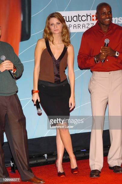 Mischa Barton and Carl Lewis during Swatch and Microsoft Announce New Swatch Watch Line Paparazzi at The Supper Club in New York New York United...