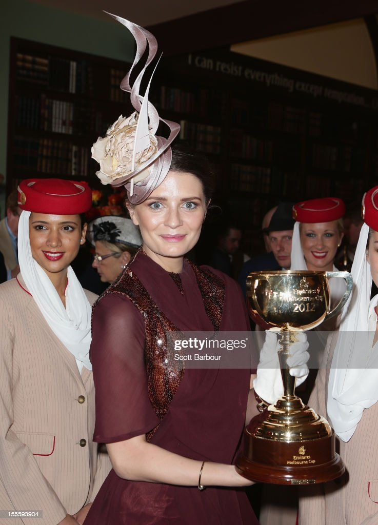 Mischa Barton holds the Melbourne Cup aloft at the Emirates marquee at the Melbourne Cup at Flemington Racecourse on November 6, 2012 in Melbourne, Australia.