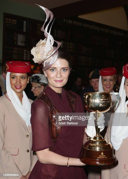 Mischa Barton holds the Melbourne Cup aloft at the Emirates marquee at the Melbourne Cup at Flemington Racecourse on November 6 2012 in Melbourne...