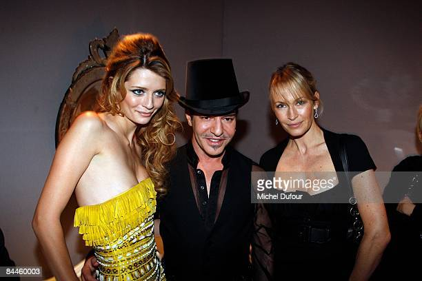 Mischa Barton, John Galliano and Estelle Lefebure attends at the Christian Dior fashion show during Paris Fashion Week Haute Couture Spring/Summer...
