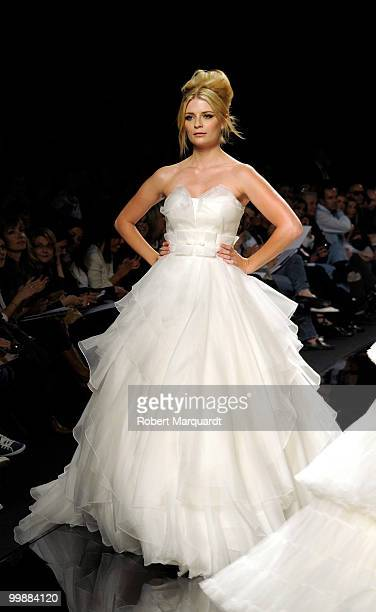 Mischa Barton presents a creation from Rosa Clara's latest bridal collection 2011, at the Fira 2 Barcelona on May 18, 2010 in Barcelona, Spain.