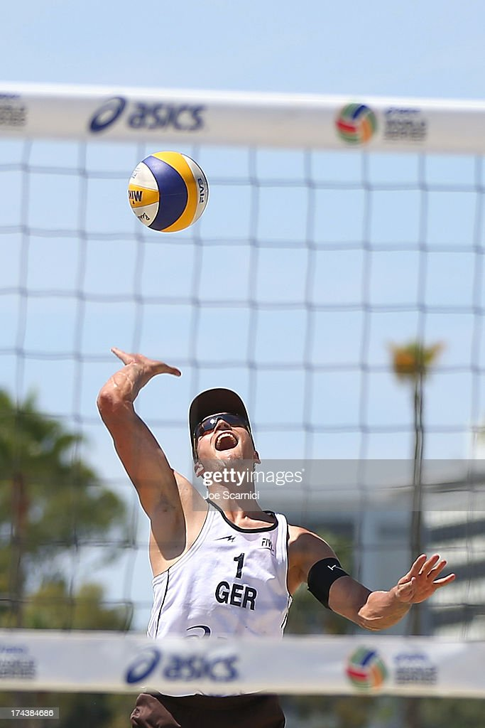 Mischa Urbatzka of Germany serves the ball during the round of pool play at the ASICS World Series of Beach Volleyball - Day 3 on July 24, 2013 in Long Beach, California.