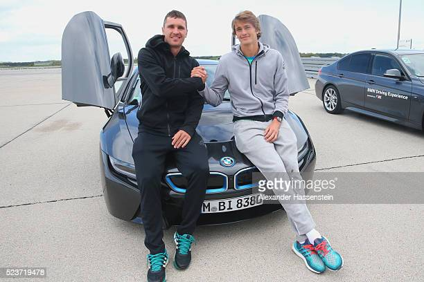 Mischa Zverev and his brother Alexander Zverev of Germany pose on a BMW i8 after his BMW DrivingExperience at BMW driving academy Maisach ahead of...