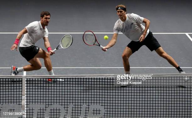 Mischa Zverev of Germany and Alexander Zverev of Germany play during the match between Raven Klassen of South Africa and Oliver Marach of Austria...
