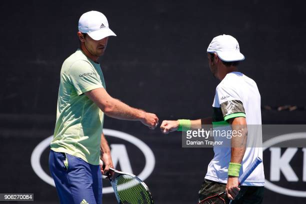 Mischa Zverev of Germany and Paolo Lorenzi of Italy talk tactics in their first round men's doubles match against Lukasz Kubot of Poland and Marcelo...
