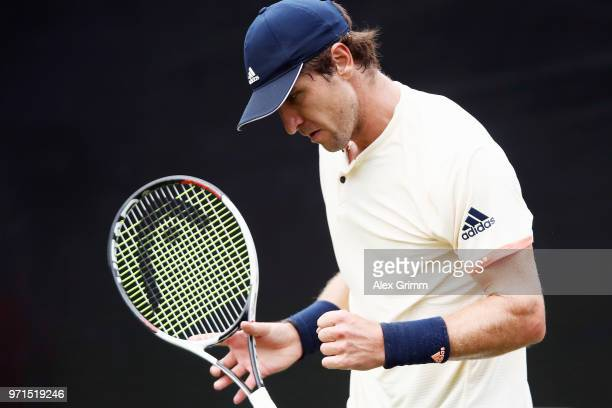 Mischa Zverev of Germany celebrates during his match against Mikhail Youzhny of Russia during day 1 of the Mercedes Cup at Tennisclub Weissenhof on...