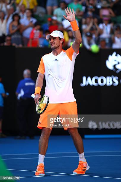 Mischa Zverev of Germany celebrates winning his fourth round match against Andy Murray of Great Britain on day seven of the 2017 Australian Open at...