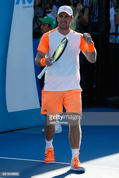 Mischa Zverev of Germany celebrates winning his second round match against John Isner of the United States on day three of the 2017 Australian Open...