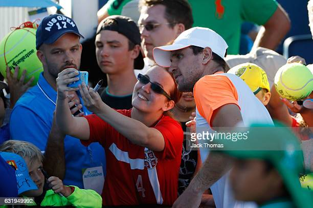 Mischa Zverev of Germany celebrates with fans after winning his second round match against John Isner of the United States on day three of the 2017...