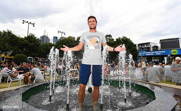 Mischa Zverev of Germany cools off in the water fountain in garden square during day eight of the 2017 Australian Open at Melbourne Park on January...