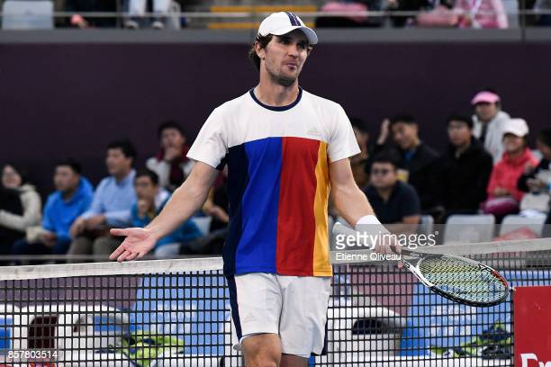 Mischa Zverev of Germany, partner of Paolo Lorenzi of Italy, reacts during their Men's doubles quarterfinal match against Juan Martin del Potro and...