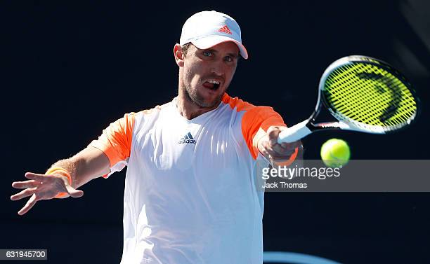 Mischa Zverev of Germany plays a backhand during his second round singles match against John Isner of the USA on day three of the 2017 Australian...
