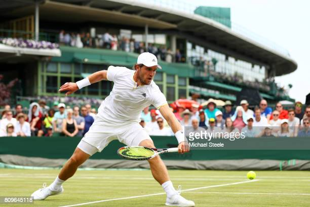 Mischa Zverev of Germany plays a backhand during the Gentlemen's Singles second round match against Mikhail Kukushkin of Kazakhstan on day four of...