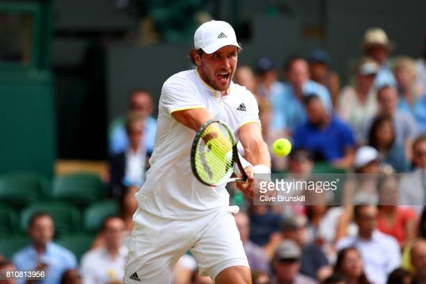 Mischa Zverev of Germany plays a backhand during the Gentlemen's Singles third round match against Roger Federer of Switzerland on day six of the...