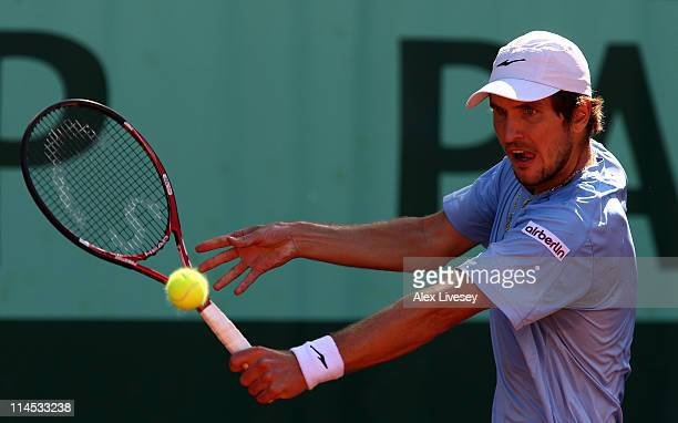 Mischa Zverev of Germany plays a backhand during the men's singles first round match between Philipp Petzschner of Germany and Mischa Zverev of...