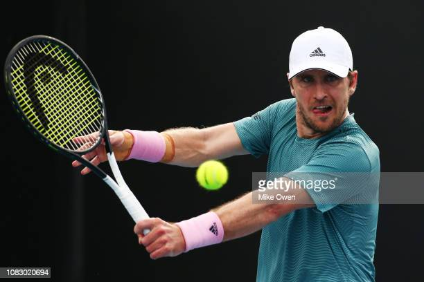 Mischa Zverev of Germany plays a backhand in his first round match against Alexei Popyrin of Australia during day two of the 2019 Australian Open at...