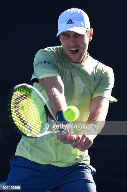 Mischa Zverev of Germany plays a backhand in his first round match against Hyeon Chung of Korea on day two of the 2018 Australian Open at Melbourne...