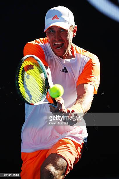 Mischa Zverev of Germany plays a backhand in his fourth round match against Andy Murray of Great Britain on day seven of the 2017 Australian Open at...