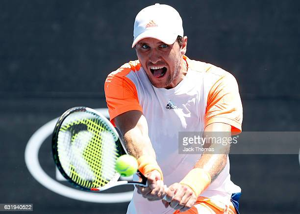Mischa Zverev of Germany plays a forehand during his second round singles match against John Isner of the USA on day three of the 2017 Australian...