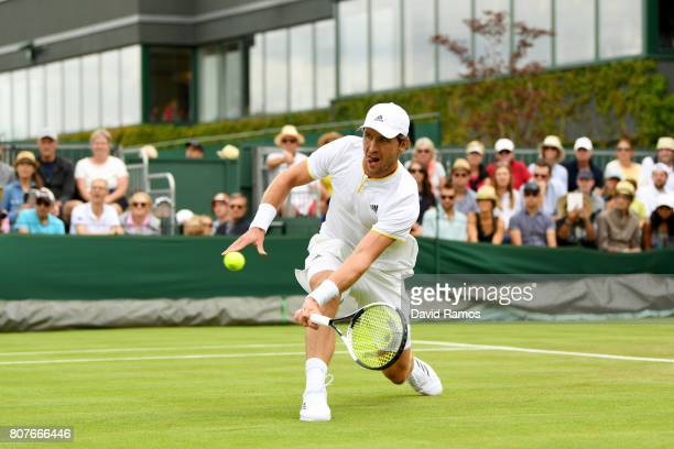 Mischa Zverev of Germany plays a forehand during the Gentlemen's Singles first round match against Bernard Tomic of Australia on day two of the...