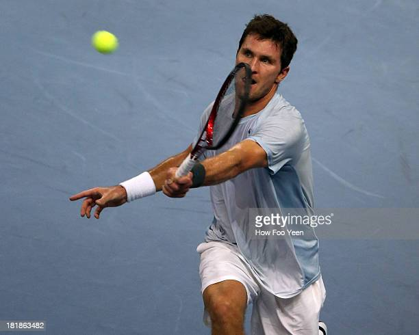 Mischa Zverev of Germany plays a return shot to Jurgen Melzer of Austria during day four of the 2013 Malaysian Open at Putra Stadium on September 26...