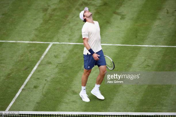 Mischa Zverev of Germany reacts during his match against Roger Federer of Switzerland during day 3 of the Mercedes Cup at Tennisclub Weissenhof on...