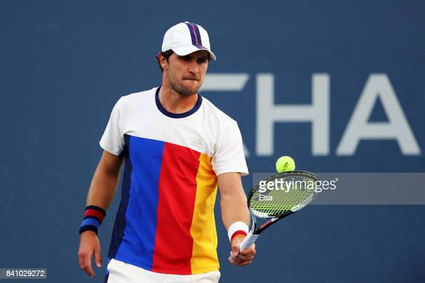 Mischa Zverev of Germany readies a tennis ball against Benoit Paire of France during their second round Men's Singles match on Day Three of the 2017...