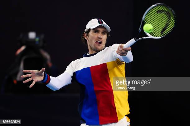 Mischa Zverev of Germany returns a shot against JanLennard Struff of Germany during the men's singles first round on day three of 2017 China Open at...