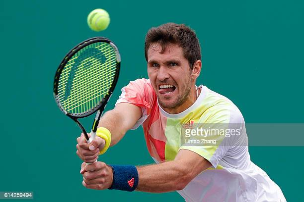 Mischa Zverev of Germany returns a shot against Marcel Granollers of Spain during the Men's singles third round match on day five of Shanghai Rolex...
