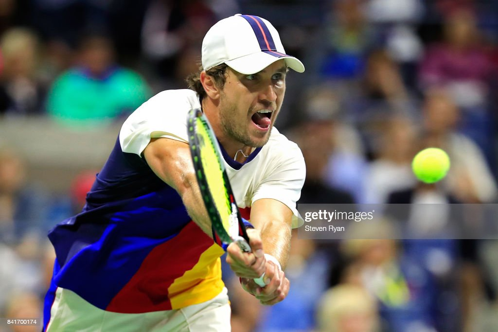 Mischa Zverev of Germany returns a shot to John Isner of the United States during their third round match on Day Five of the 2017 US Open at the USTA Billie Jean King National Tennis Center on September 1, 2017 in the Flushing neighborhood of the Queens borough of New York City.