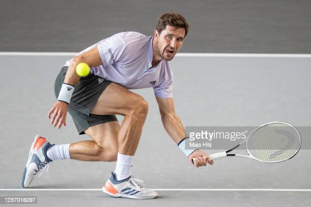 Mischa Zverev of Germany returns the ball to Roberto Bautista Agut of Spain of during day 6 of the tennis tournament bett1ACES at Hangar 6 of the...